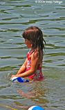 Little girl in Walden Pond