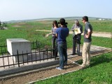 now we are at the southern mass grave, explaining what happened here for French TV