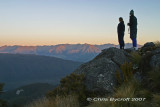 Fliss and Roy check sunset lighting on Takitmu Range