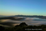 Slow exposure of night light, fog, and Takitmu Range