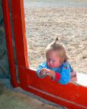 baby in ger door