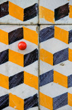 The red ball in the tiles with an optical ilusion