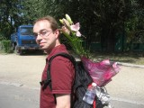 Me, carrying flowers the 2nd AE gave to Francine for her birthday. If I spoke Hungarian I'd have bought flowers that nice, too!