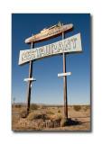 'Road Runner's Retreat' SignEast Amboy, CA