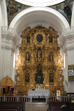 Note the detailed gold carvings behind the baroque altar.