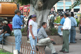 Honduran men passing time together in Parque Central.