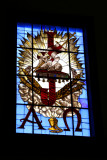 Some of the stained glass windows are traditional, and some are more modern like this one.