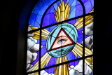 This stained glass window represents the Eye of God.