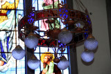 The chandeliers in the Basilica of Suyapo reflected some of the vibrant colors off of the stained glass windows.