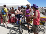 Burning Man has lots of bikes, costumes and color