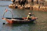 Pêcheur dans son bateau-panier