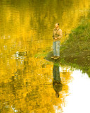 Reflection Of A Fisherman