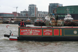 Passing moored up Tugs on the Thames Tideway