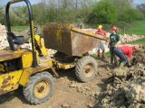 Loading clay by hand after Liz broke the excavator.