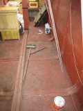 Some of the floor panels haviving been wire brushed using angle grinders