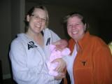 Leslie and Tisha holding baby Eva