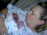 Leslie holding Eva for the first time
