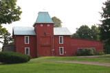 red barn with a moustache