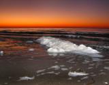 Écume de mer et soleil couchant