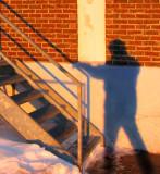 L'ombre montant l'escalier