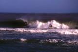 surfers riding a tube, Sigatoka