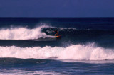 Surfer riding a wave, Sigatoka