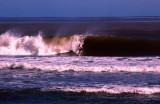 Surfer riding in a big wave, Sigatoka