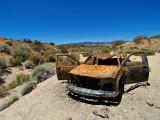 Old shot up car, Desert ornaments.