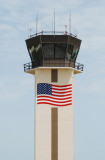 Air traffic control tower with American flag