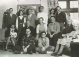 Dad's family (1945).  Tim is seated with legs crossed front and center.