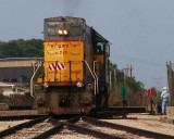 Conductor John throws switch for Local UP Engine 717 at Sterling.JPG