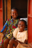 Boy in a beautiful West African shirt and girl in a frilly dress, Abomey