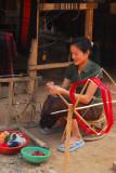 Lao woman with a spinning wheel, Ban Xang Hai