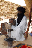 Tuareg using a bellows to heat the coals