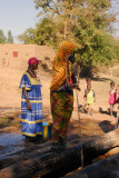 Women drawing water from the old well