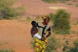 Woman carrying a baby, Labbézanga, Niger