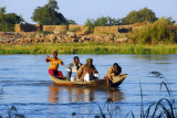 Pirogue ferries men across the Niger from the island to Ayorou