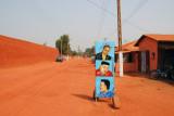 Sign outside a beauty salon across from the Royal Palace, Abomey
