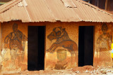 House with paintings similar to the palace bas-reliefs, Abomey