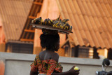 Woman carrying a tray of bananas, Abomey