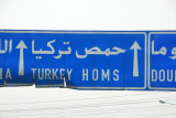 Lots of overhead signs on the Syrian roads have been hit by oversized vehicles