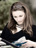 Young woman reading at Quay