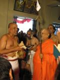 Srikaryam Sri Ananthrangachar Swami is giving Poorna Kumbha Mariyade to H H Andavan Swami