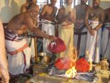 Srikaryam Swami submitting Poorna Ahuthi in Homam