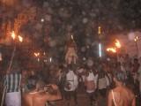 PerumAL jumping on the Kudhirai nampiran-vaiyALi flying past fire torches(theevatti).jpg