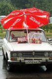 Russian Vendor Keeps Dry With Coke Umbrella