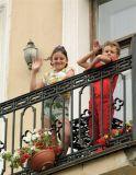 Young St. Petersburg Children wave to onlookers