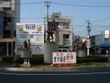Oinari-san statues outside Toyokawa-eki
