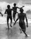 Boys running into the surf at Lake Tanganyika, ca. 1930