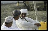 Omani men having a small talk at Sohar Bull fight rink